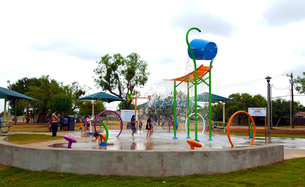Kids playing together in the water at Scarborough Park Splash Pad