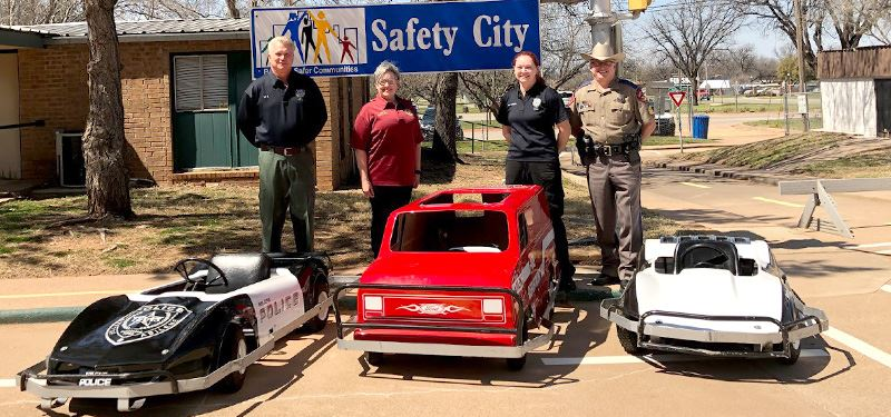 Safety City staff with their cars