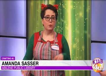 Library Assistant Being Interviewed About Holiday Workshop
