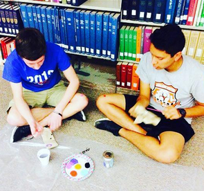 Teen Boys Creating Art During Activity Night Series