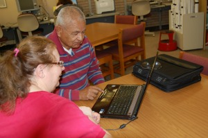 Library Visitors Working on a Laptop