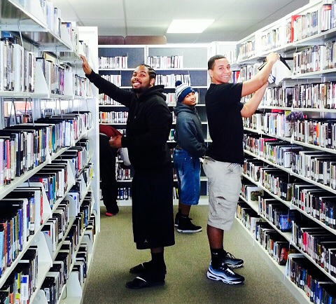 Library Volunteers Putting Books on Shelves